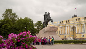 Tourists are photographed against the background of the monument to Peter the Great. Saint-Petersburg, Russia - July 3, 2017: Tourists are photographed against stock video footage