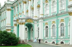 Tourists are photographed in museum costumes at the Hermitage Museum in St. Petersburg stock photography