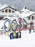 Tourists are photographed near the Olympic rings, Sochi. Sochi - March 29, 2017: A group of tourists in bright winter clothes is photographed near the Olympic Stock Images