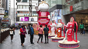 Tourists are photographed among the symbol of the Chinese New Year Royalty Free Stock Image