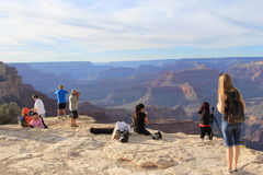 Tourists and photographers in Grand Canyon National Park October 2016. Tourists and photographers enjoy view on the  survey site of Grand Canyon National Park Royalty Free Stock Photos