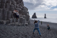Tourists photographing at the Black Beach, Iceland Stock Photography