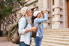 Tourists photographing building Royalty Free Stock Photo