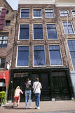 Tourists photographing the original anne frank house in amsterda Royalty Free Stock Image