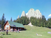 Tourists at the Piatra Singuratica Chalet. In Carpatian Mountains Royalty Free Stock Photo