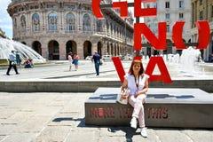 Tourists  at  Piazza De Ferrari ,Genoa , Italy. Piazza De Ferrari is the main square of Genoa Stock Photo