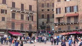 Tourists on the Piazza del Campo, September day. Siena, Italy. SIENA, ITALY - SEPTEMBER 24, 2017: Tourists on the Piazza del Campo, September day stock video footage