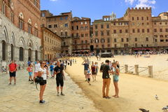 Tourists in the Piazza del Campo in Siena, Italy Royalty Free Stock Photography