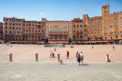 Tourists in Piazza del Campo, Siena, Italy Royalty Free Stock Images