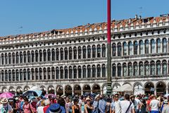 Piazza San Marco. Tourists in the Piazza San Marco St Mark`s Square, the main public square in the city and its religious and political center, one of the best Royalty Free Stock Images