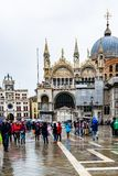 Tourists in Piazza San Marco St Marks Square. San Marco Basilica Patriarchal Cathedral of Saint Mark, Venice, Italy stock photos