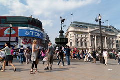 Tourists in Picadilly Circus, London Royalty Free Stock Photo