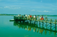 Tourists at a pier of the Federsee Royalty Free Stock Photos