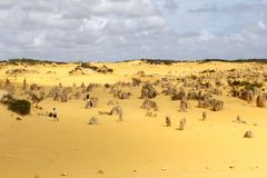 Tourists in the Pinnacles desert in Nambung National Park, Australia Royalty Free Stock Images