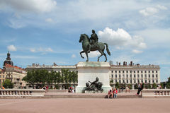 Tourists on Place Bellecour. LYON, FRANCE, MAY 29, 2014 : Tourists on Place Bellecour. Place Bellecour is a large square in the centre of Lyon, and  is the Stock Images