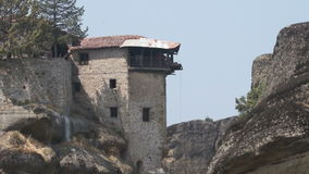 Tourists on a platform lift one of the monasteries in Meteora, Greece stock footage