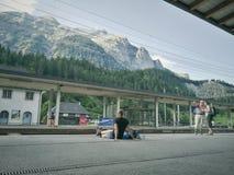 Tourists at platform. At Switzerland Royalty Free Stock Photos