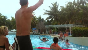 Tourists Play Games at Resort Swimming Pool in Cuba stock footage