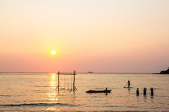 Tourists play in the water sea during the sunset at area ao bang bao Koh kood island Trat, Thailand.  stock image