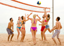 Tourists playing beach volley near sea Royalty Free Stock Photography