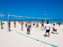 Tourists playing volleyball at a cuban beach Stock Images