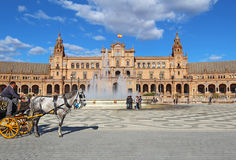 Tourists at the Plaza de Espana in Seville, Spain Stock Images