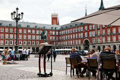 Tourists at Plaza Mayor. MADRID, SPAIN - OCTOBER 2: Tourists sitting at restaurant at Plaza Mayor ( Main Square ) October 2, 2013 in Madrid - Spain royalty free stock photo