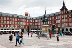 Tourists at Plaza Mayor. MADRID, SPAIN - OCTOBER 2: Tourists walking at Plaza Mayor ( Main Square ) October 2, 2013 in Madrid - Spain royalty free stock photography