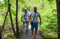 Tourists in Plitvice lakes in Croatia Royalty Free Stock Images