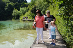 Tourists in Plitvice lakes in Croatia Royalty Free Stock Photography
