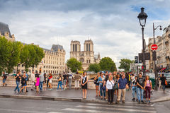 Tourists on Pont Saint-Michel. Bridge across Seine river, Paris Royalty Free Stock Image