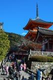 Tourists at popular three-story pagoda at Kiyomizu-dera in Kyoto, Japan royalty free stock images