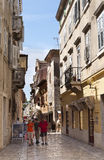 Tourists in Porec (Parenzo), Istra, Croatia. Tourists walk along the narrow streets of the Ancient Porec (Parenzo), Istra, Croatia Stock Photo