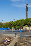 Tourists in the port of Barcelona with Colon in the background. Stock Image