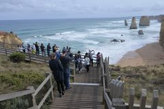 Tourists at Port Campbell National Park Victoria Australia. Tourists at Port Campbell National Park, looking at the Twelve Apostles along the Great Ocean Road in royalty free stock photo