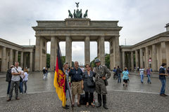Tourists pose for photographs in front of the The Brandenburg Gate in Berlin in Germany. Royalty Free Stock Images