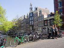 Tourists pose for photos in Amsterdam Royalty Free Stock Photo
