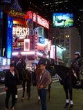 Tourists pose for photos with New York City Police Department Mounted Unit. NYPD Mounted Unit officers patrol Times Square on horseback. The New York City Police Royalty Free Stock Image