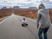 Tourists posing for selfie photo at the Monumnet valley road made famous in the Forest Gump film stock photo