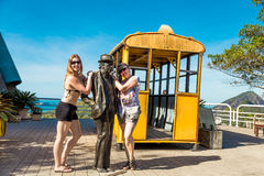 Tourists posing on the top of Sugarloaf Mountain in Rio de Janeiro, Brazil Stock Image