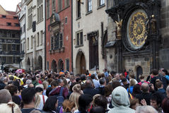 Tourists in Prague. Tourists observe the procession of the clock in the Old Town Square in Prague Stock Image