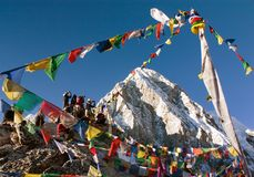 Tourists with prayer flags on view point Kala Patthar Stock Images