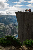 Tourists on Preikestolen cliff in Norway, Lysefjord view. Pulpit rock Royalty Free Stock Image