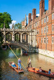 Tourists on punt trip along River Cam near Bridge of Sighs of St Royalty Free Stock Photos