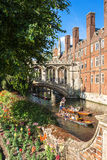 Tourists on punt trip along River Cam near Bridge of Sighs of St Royalty Free Stock Images