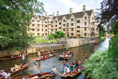 Tourists on punt trip along River Cam near Old Provost`s Lodge. Stock Photos