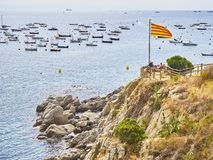 Tourists in Punta dels Burricaires viewpoint. Calella de Palafrugell, Girona, Costa Brava, Catalonia, Spain royalty free stock photo