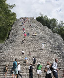 Tourists at the Pyramid Nohoch Mul of the Mayan Coba Ruins, Mexico.  stock photo