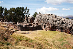 Tourists in qenqo. Tourists around the incas ruins of qenqo near cusco in peru Stock Image