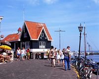 Tourists on quayside, Volendam. Royalty Free Stock Photo